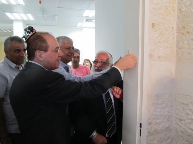 Minister Silvan Shalom affixing the mezuzah